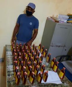 2 bootleggers held with illicit liquor