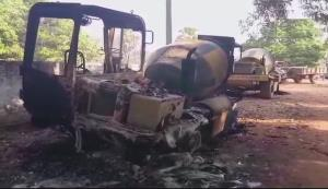 Naxals torch vehicles, machines at road construct...