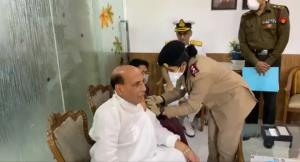 Defence Minister Rajnath Singh takes first dose o...