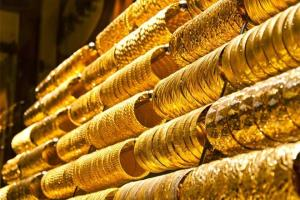 Gold slumps Rs 290 on weak global cues, muted dem...