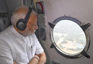 PM announces immediate relief of Rs 500 cr to flo...