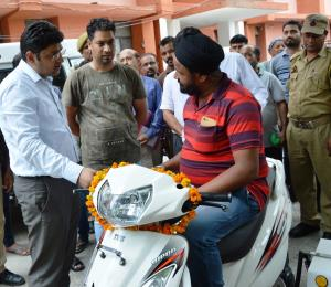 DC Kathua presents motorized tricycles to physica...