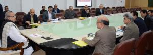 Governor reviews Action Plan for completion of la...