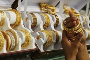 Gold firms up by Rs 125 per 10 gm, silver remains...