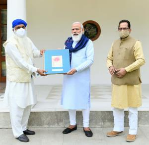 PM Modi releases book on life and ideals of Guru ...