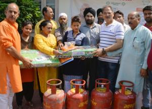 Dy CM hands-over LPG connections to beneficiaries...
