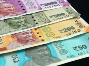 Rupee rises 11 paise to 71.74 against US dollar i...