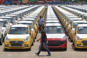 Vehicle registrations fall by over 13 pc in Feb: ...
