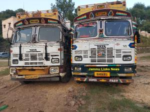 Two trucks with same number plates seized, 2 arre...