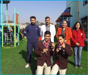 Students of Doon International School bring laure...