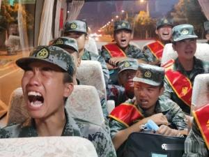 Video shows PLA recruits sobbing while heading to...