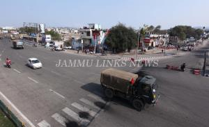 Curfew continues in Jammu, Army stages flag march...