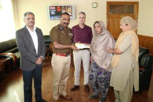 DGP presents cheques to martyrs families