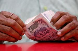 Rupee falls 59 paise to 71.40 against US dollar i...