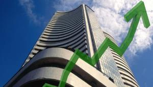 Sensex jumps over 250 pts; Nifty breaches 11,000 ...