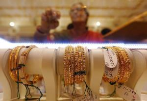 Gold slips Rs 130 on tepid demand, weak global cu...