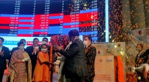 Yogi Adityanath rings bell at BSE at listing of L...