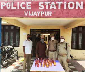 Man held with illicit liquor