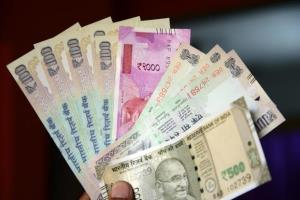 Rupee crashes 68 paise against dollar after Gujar...