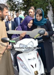 Mehbooba Mufti hands over motorized bicycles amon...