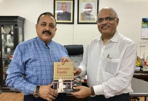Dr Jitendra presented with book on