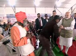 PM Modi distributes assistive aids, devices to se...