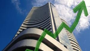 Sensex rises over 200 pts to hit record high in e...