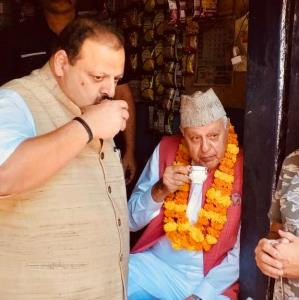 Farooq sips tea at a stall in congested old Jammu...